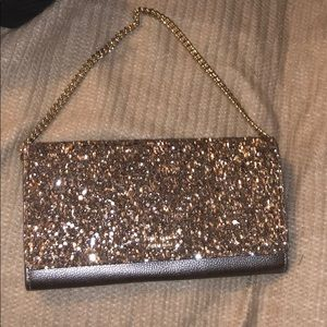 Beautiful gunmetal clutch. Dress any outfit up.
